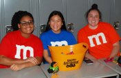 Jaylen Haltiwanger, Megan Uong, and Riley Cadogan at Project Pumpkin.