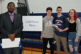 From left Tiance Tillman of Bank of Canton, with sophomores Noah Quinn, Adam Pollard and Ava Glushik. Tillman spoke to students about the costs of different cell phone plans.