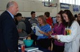Jeffrey Phelps of Amos Phelps and Son Insurance Co. discusses insurance costs with Sophomores Mia DeAngelis, Claudia Abouzeid and Angelina Hussey with Jeffrey Phelps of Amos A. Phelps andSon Insurance Company at the Insurance table during the third annual Credit forLife Fair at Rockland High School on Nov. 5.