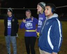 Matt Bruzzese, Lauren Buker, Hannah Wyllie and Dante Vasquez at the captains' coin flip before the game