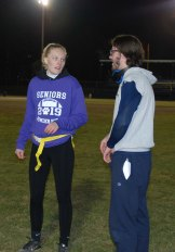 Quarterback Hannah Wyllie get instructions from Owen Shea