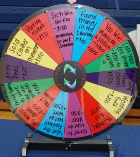 "Students spin the wheel at the ""That's Life"" table."