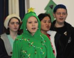 Kayla Mantell is decked out in holiday style with the chorus at Memorial Park.