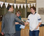 Robert Ivil receives his certificate signifying his achieving high honors this year.