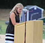 Maddie Gear, Secretary of NHS, reads the Senior Roll of the Pentelic Chapter of the National Honor Society.